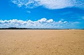 Great sand beach with blue sky during tide in the Bretagne in France