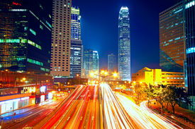 stock photo of hong kong bridge  - Colorful city night with lights of cars motion blurred in hong kong - JPG