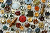 Craft Sewing Buttons On Woven Fabric Background