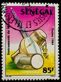 SENEGAL - CIRCA 1985: A stamp printed by Senegal, shows Drums, stringed instrument, circa 1985