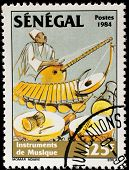 SENEGAL - CIRCA 1985: A stamp printed by Senegal, shows Musician playing balaphone, drums, circa 198
