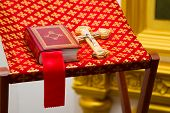 image of christening  - Holy Bible and Orthodox cross prepared for christening ceremony in russian church - JPG