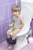 Baby On The Toilet