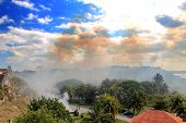 foto of el morro castle  - Burning of grass at the fortress El Morro in Cuba - JPG