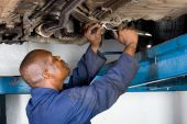 Mechanic  working on vehicle