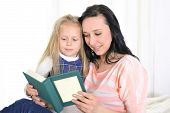 Attractive Woman With Beautiful Daughter Reading Book