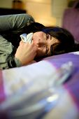 stock photo of kidnapped  - Domestic violence on young woman at home - JPG
