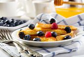 stock photo of french toast  - french toasts with fresh berries on a plate - JPG
