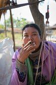 Burmese Market Woman Smoke Cheroot Cigar