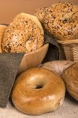 Assortment of freshly baked bagels including plain, everything, onion, sesame seed, cinnamon, bluebe