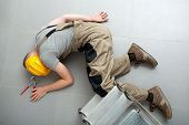 Unconscious Handyman On The Floor