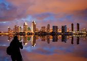 San Diego Skyline At Dusk Reflected In Sea