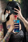 Sexy Woman taking off a Ammo Gas Mask and drinking