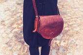Rear View Shot Of Woman With Leather Handbag