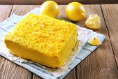 Tasty lemon cake on wooden table