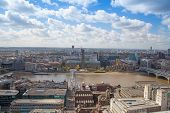 LONDON, UK - AUGUST 9, 2014 London view from St. Paul cathedral. River Thames and office buildings