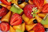 Fresh fruits salad on plate close up
