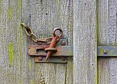 Iron Latch On The Wooden Door