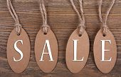Sale tags on wooden background