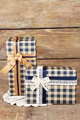 Gift boxes with colorful ribbon on wooden background