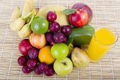 fruits and juice on wooden background