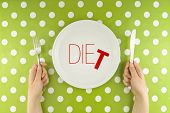 Hands Hold Flatware Above Dieting Plate