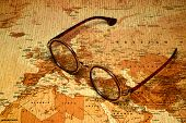 Glasses on a map of a world
