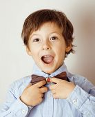 little cute boy in bowtie smiling, making funny faces