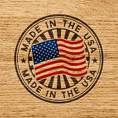 Made in the USA. Stamp on wooden background