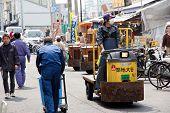 Man transporting fishes at Tsukiji Market