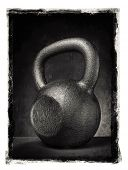 Grunge photo of a rough and heavy kettlebell.