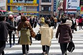 Pedestrians cross at Shibuya Crossing