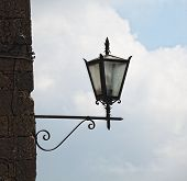 Detail of historic streetlight in Pienza. Tuscany, Italy poster