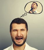 concept photo of stressed screaming man. in speech balloon crying man with gun. photo over grey back