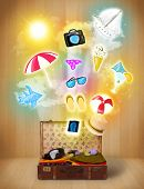 Tourist bag with colorful summer icons and symbols on grungy background