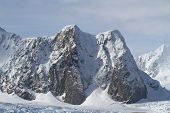 Mountains Of The Antarctic Peninsula Summer Day