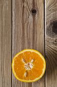 Cut Orange Overhead On Wood