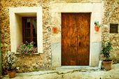 Vintage photo of traditional house in mediterranean village in Mallorca, Spain