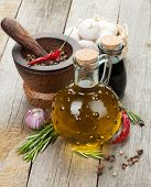 Herbs, spices and seasoning on wooden table background
