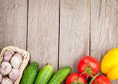 Fresh ripe vegetables on wooden table with copy space