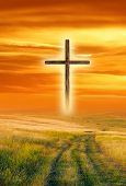 image of forgiven  - A wooden cross on a field at sunset - JPG