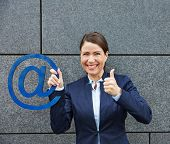 Happy business woman with email symbol holding her thumbs up