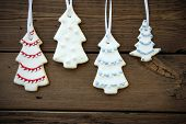 Four Christmas Tree Cookies On Wood