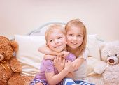 Portrait of two cute kids having fun at home, brother and sister playing in bedroom, healthy lifesty