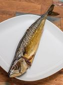 Whole Smoked Mackerel On A Wooden Table