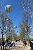 London - April 5. Pierced Aluminium Spheres Hanging Across Pathway On April 5, 2014