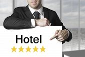 Businessman Pointing On Sign Hotel Rating Stars