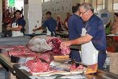 Butcher Preparing A Tuna At The Fish Market Of Madeira, Portugal
