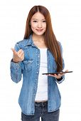 Woman hold tablet and thumb up