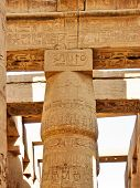 Majestic chapiter of grandiose column in the hypostyle hall in Karnak Temple